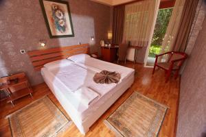 Posteľ alebo postele v izbe v ubytovaní Leonardo Hotel
