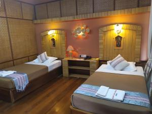 A bed or beds in a room at Kaday Aung Hotel