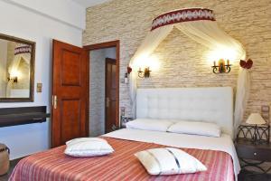 Ένα ή περισσότερα κρεβάτια σε δωμάτιο στο Aegean Wave - Faros
