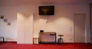 A television and/or entertainment center at K&M Hostel