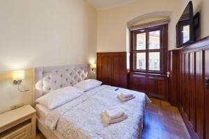 A bed or beds in a room at Residence u Vejvodů