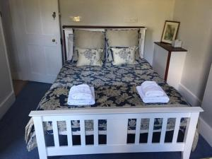 A bed or beds in a room at The Old Alma Inn Ltd