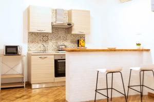 A kitchen or kitchenette at Maribì - Casa Vacanze