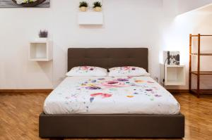 A bed or beds in a room at Maribì - Casa Vacanze