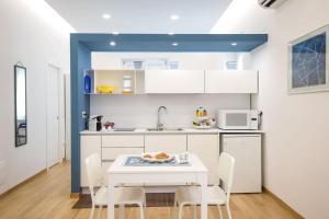 A kitchen or kitchenette at Pisacane Loft