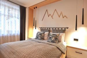 Łóżko lub łóżka w pokoju w obiekcie Apartamenty Tatry Garden&Spa