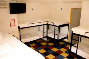 A bunk bed or bunk beds in a room at Bud Gett Hostels
