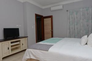 A bed or beds in a room at SWEET DREAM