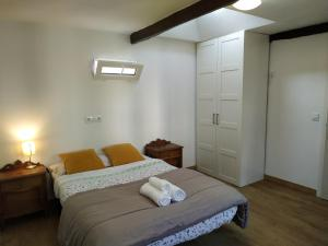 A bed or beds in a room at Pension Alver
