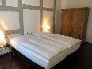 A bed or beds in a room at Landgasthof Adler Bett & Frühstück