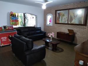 A seating area at Hotel Portal da Praia