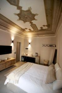 Letto o letti in una camera di Casa Nostra Luxury Suites