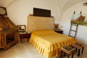 Letto o letti in una camera di Masseria Lama Di Coccaro