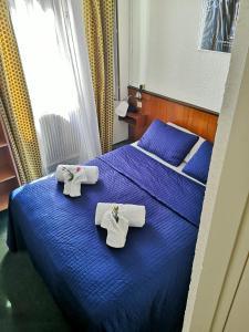 Un ou plusieurs lits dans un hébergement de l'établissement Azurene Royal Hotel