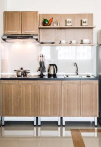 A kitchen or kitchenette at Winner Serviced Apartment