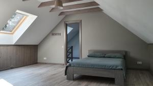A bed or beds in a room at Sea House Dzelmes