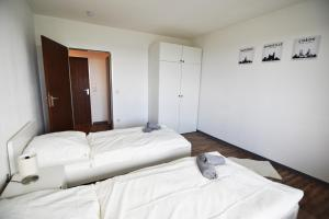 A bed or beds in a room at Ferienwohnung in Duisburg