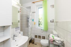 Kúpeľňa v ubytovaní Apartment Green Forest