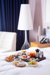 Кровать или кровати в номере Radisson Rosa Khutor