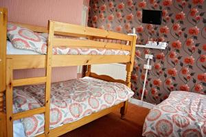 A bunk bed or bunk beds in a room at Tobermory Hotel