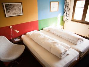 A bed or beds in a room at Nangijala Hostel