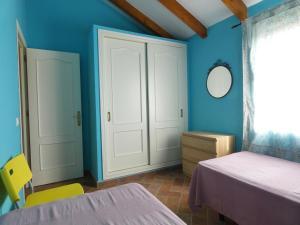 Cama o camas de una habitación en Arriba y Abajo Cadiz