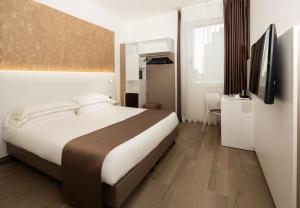 A bed or beds in a room at Best Western Hotel Biri