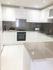 A kitchen or kitchenette at Zenobia London Luxury Apartments