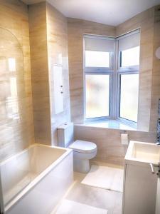 A bathroom at Zenobia London Luxury Apartments