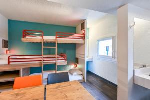 A bunk bed or bunk beds in a room at hotelF1 Marseille EST