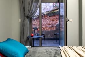 Кровать или кровати в номере RentalSPb on Orlovsky Pereulok 3