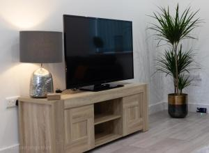 A television and/or entertainment center at Location Location Luton