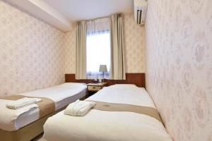 A bed or beds in a room at New Osaka Hotel Shinsaibashi