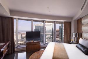 A television and/or entertainment center at City of Dreams- The Countdown Hotel