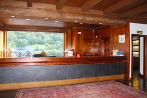 The lobby or reception area at Hotel Yoy Tredòs