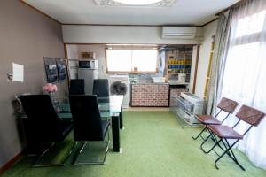 A kitchen or kitchenette at Guesthouse TAKADA