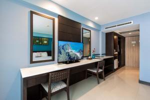 Телевизор и/или развлекательный центр в Buri Tara Resort
