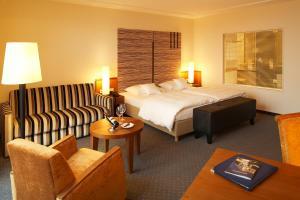 Ein Bett oder Betten in einem Zimmer der Unterkunft Best Western Plus Arosa Hotel
