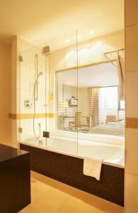 Ein Badezimmer in der Unterkunft Best Western Plus Arosa Hotel