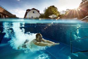 The swimming pool at or near Hotel Landhaus Moserhof
