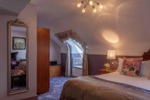 A bed or beds in a room at Clontarf Castle Hotel