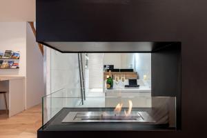 A kitchen or kitchenette at La suite numéro 1