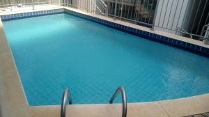 The swimming pool at or near Faria Lima Flat Service