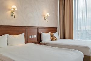 Кровать или кровати в номере Ural Tau r