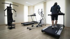 The fitness centre and/or fitness facilities at GTV Hotel