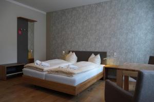 Ein Bett oder Betten in einem Zimmer der Unterkunft Gästehaus Nikolai