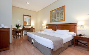 Cama o camas de una habitación en Hotel Bécquer