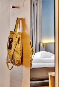 Cama o camas de una habitación en Comfort Hotel Xpress Tromsø