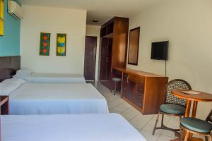 A bed or beds in a room at D Beach Resort