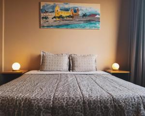 Una cama o camas en una habitación de America Del Sur Calafate Hostel